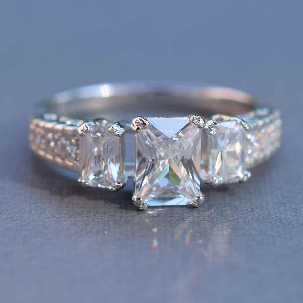 past present and future emerald cut three ring