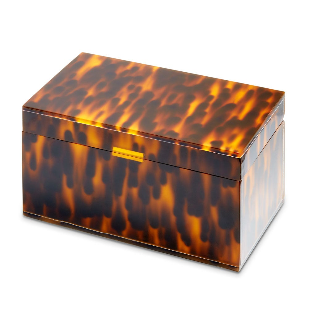 Tortoise Acrylic Jewelry Box Every girl needs the Tortoise Acrylic Jewelry Box to store jewelry, trinkets, and whatever else you can fit.  This classic jewelry box is the perfect gift for any special occasion.    Details: • Tortoise Acrylic Jewelry Box  • 7 Inches Long