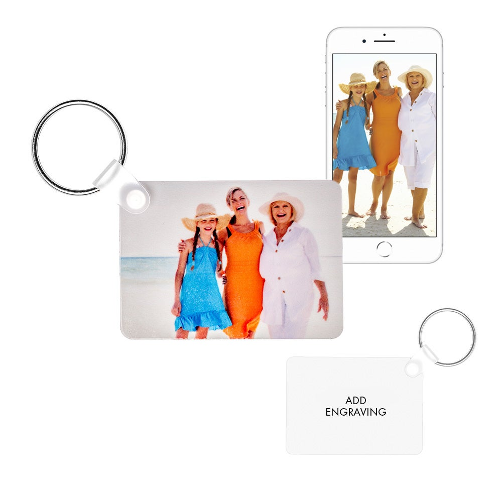Rectangle Custom Photo Keychain Carry your favorite memory with you wherever you go with this Rectangle Custom Photo Keychain. Easily personalize the rectangle photo keychain by uploading one of your favorite photos, to be customized on the keychain. In addition to the photo, you can write a personal message on the back of the custom photo keychain. The rectangle photo is durable and measures 2 1/4 inches wide and 1 5/8 inches tall. The Rectangle Custom Photo Keychain makes a great gift for moms and dads to showcase their beautiful family.  Details: • Rectangle Photo Keychain • Personalized Message on Back • 2 1/4 Inches Wide