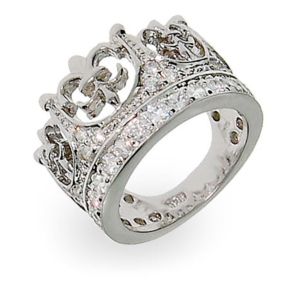 Fleur de Lis Crown Tiara Pave CZ Ring With the acutely recognizable symbol of the lily of France, this Fleur de Lis cubic zirconia crown tiara ring sparkles with an almost royal air as the proud symbols curve around the ring. With a stylized iris giving rise to this special symbol, this ring holds a little something extra that design alone cannot obtain. The fleur de lis ring measures 0.5 inches wide and weighs a fine 6.9 grams. With a total carat weight of 1.23 carats, this Fleur de Lis Crown Tiara Pave CZ ring is a fine find for the serene at heart.   Details: • Crown Ring • Fleur de Lis' in Crown Top • White Cubic Zirconia